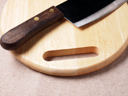 cleaver: meat cleaver on cutting wood board