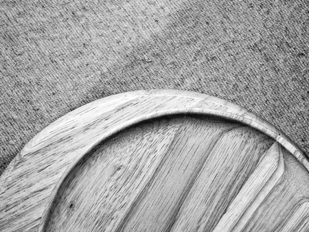 monotone: Wood plate on fabric, monotone color background