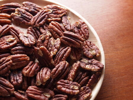 whole pecans: Pecan Nuts on plate Stock Photo