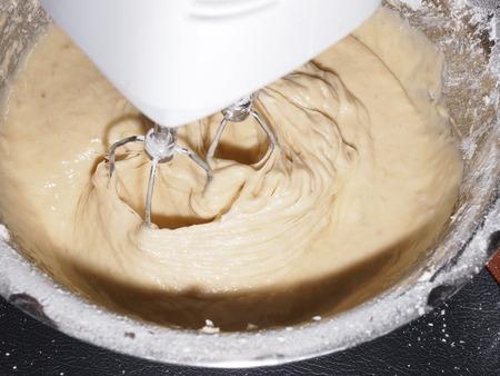 cake mixer: Mixing egg, banana, cake flour in bowl with motor mixer, baking banana cake
