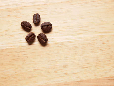 Coffee crop beans on wood texture background photo