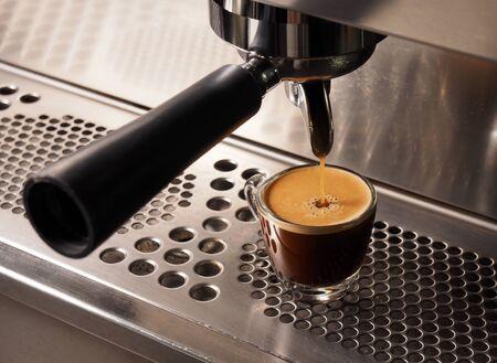 espresso machine: Hot coffee flow to a cup on espresso machine