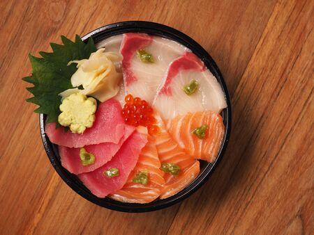 Hamachi, salmon and tuna sashimi on rice, donburi, japanese food