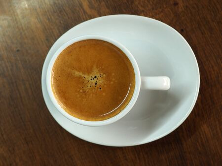 espresso cup: Cup of hot espresso coffee on wood table, background