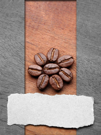 Coffee crop beans with text paper on wood texture background Stock Photo