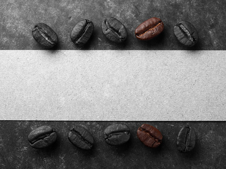 Coffee crop beans with paper on wood texture background