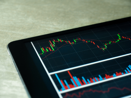 Smartphone Tablet with stock chart investment on screen Stock Photo