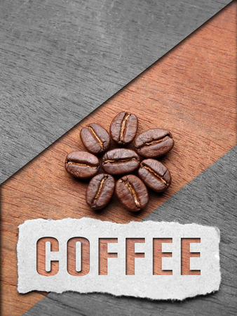 Coffee crop beans on wood texture with coffee text background