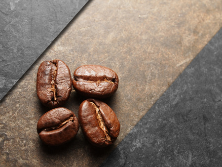 Roasted Coffee beans on texture floor Stock Photo