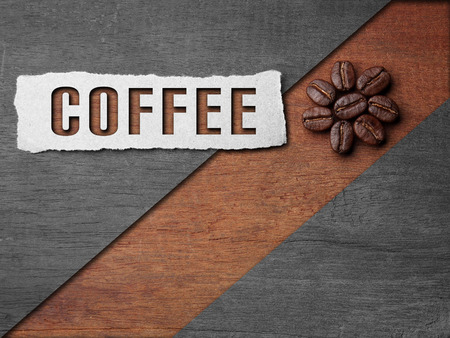 Coffee crop beans with paper and coffee text on wood texture background