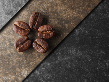 Coffee crop beans on wood, coffe texture background