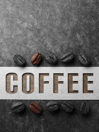 Coffee crop beans with paper on wood texture with coffee text background