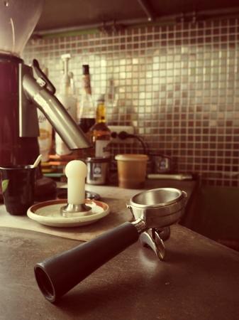 hot temper: Portafiler for espresso coffee machine on table