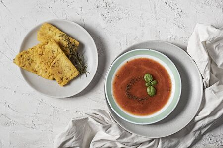 Spicy tomatoes soup with grilled polenta and rosemary Banco de Imagens