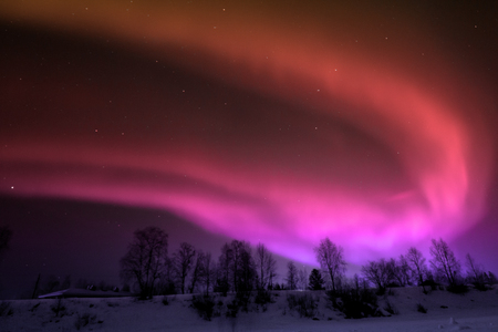 Northern lights in Lapland. Aurora Borealis Stock Photo