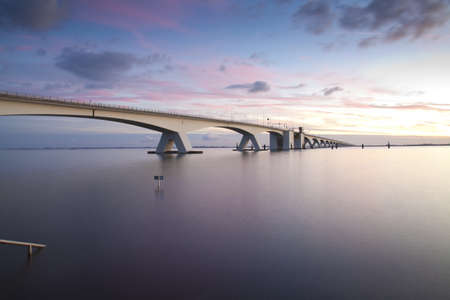 waterworks: Zeeland bridge by sunset Stock Photo