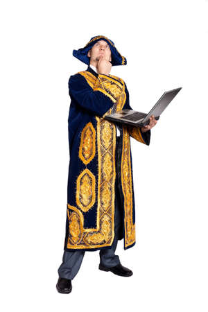 kazakh: Man in national Kazakh costume with laptop