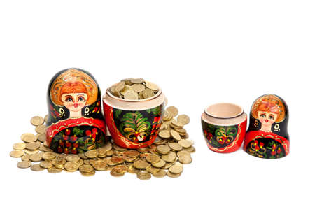 Two Matryoshkas. One Matryoshka is full of coins and another is empty at white background photo