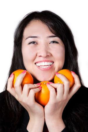 kazakh: Kazakh Girl with tree oranges isolated on white background