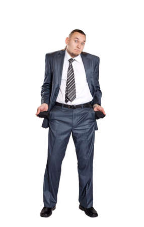 Poor businessman with empty pockets isolated on white background photo