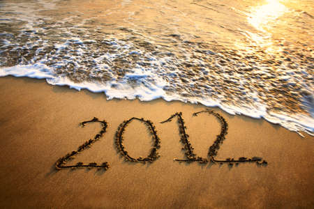 The welcome of the new year 2012 dramatic message in the sand at the beach near the ocean Stock Photo