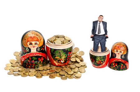 matryoshkas: Two Matryoshkas. One Matryoshka is full of coins and another is empty with poor businessman pulling out his pockets in it at white background Stock Photo