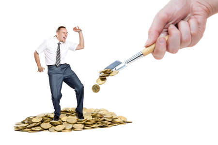 Hand with Shovel strewing coins on pile of money and happy businessman dancing on it at white background Stock Photo - 9257412