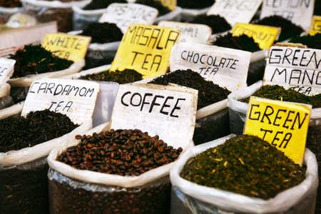 Various of Indian spices on the Anjuna flea market in India, Goa. Masala tea, coffee, cardamom tea, green tea, white tea, chocolate tea etc photo