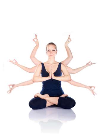 namaste: Hermosa mujer con muchas manos haciendo gestos mudr?s sentado en lotus padmasana pose en fondo blanco Foto de archivo