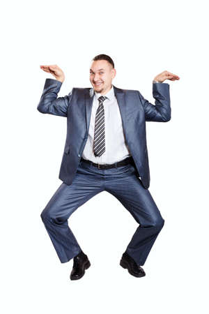 Happy businessman dancing isolated on white background Stock Photo