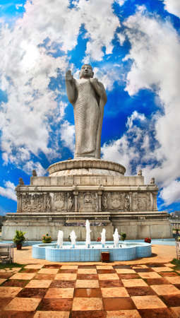 andhra: Standing Buddha statue on water in Hyderabad, Andhra Pradesh, India. Floor like a chess desk and fountain near by