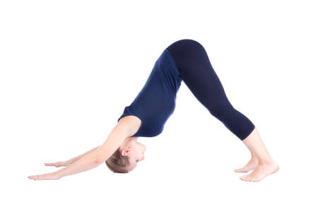 salutation: Beautiful Caucasian woman in blue Capri and top doing Adho Mukha Svanasana seventh step of surya namaskar, sun salutation Exercise at white background