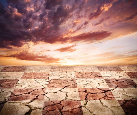 drought earth with chess desk texture at storm dramatic sky background photo