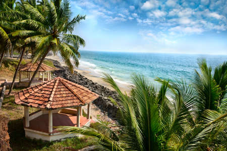 Beautiful view of ocean, beach, summer houses and palm trees in Varkala, Kerala, India Stock Photo