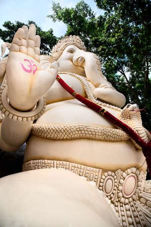 Big Ganesha statue with om symbol on his hand and cobra near by in Shiva temple, Bangalore, Karnataka, India photo
