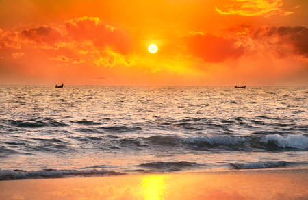Two Fisherman boats catching fish in the ocean at sunset dramatic sky background in Kerala, India Stock Photo - 10349055