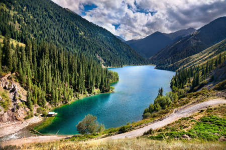 Beautiful view of high mountain lake Kolsai in Kazakhstan, central Asia photo