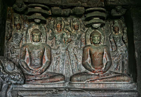 Ellora Cave with statue of Buddhas in meditation inside in Maharashtra, India photo