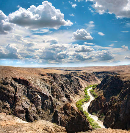 mountain oasis: Beautiful river in Charyn canyon and blue sky with clouds in Kazakhstan Stock Photo