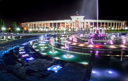 first sight: Beautiful view of big circle glowing Fountain in dendra park of first president Nursultan Nazarbayev at night in Almaty, Kazakhstan