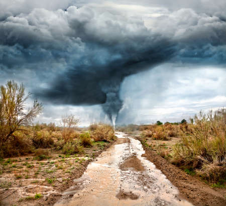 windstorm: Hurricane, flooded road in prairie and dramatic sky background. Represent apocalypse and disaster