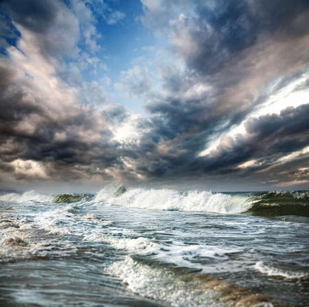 storm sea: Ocean with waves and dramatic blue sky with clouds