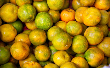 Various Indian oranges in the market photo