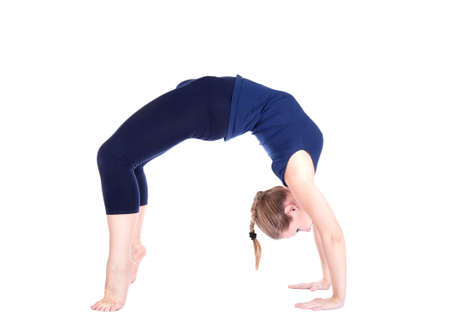backward: Yoga chakrasana backward bending wheel pose pose by beautiful Caucasian woman in blue Capri and top at white background. Free space for text