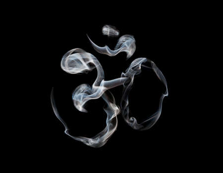 sadhu: Om symbol from smoke at black background. Free space for text and Can be used as template Stock Photo