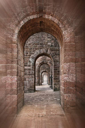 Basilica of Bom Jesus Church empty corridor with brick walls and arches in Panaji, Old Goa, India