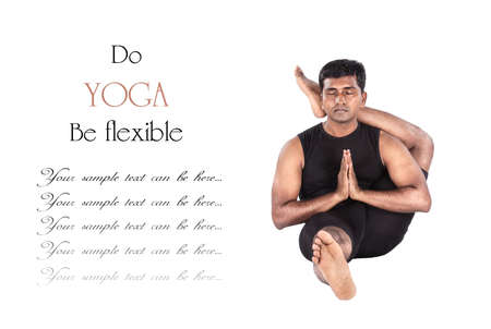 Yoga eka pada shirshasana foot behind the head pose by Indian man in black cloth isolated at white background. Free space for text and can be used as template for web-site photo