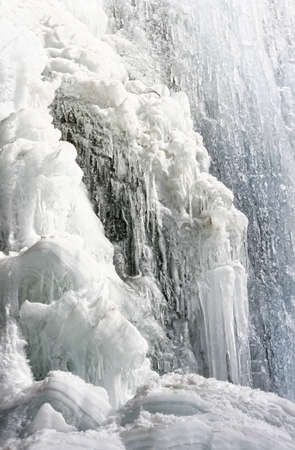 Frozen waterfall with icicles in mountains of Kazakhstan  photo