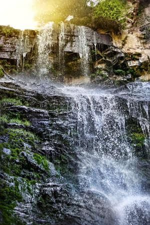 issyk kul: Waterfall in mountains with sunshine in Jety Oguz, Issyk Kul, Kyrgyzstan
