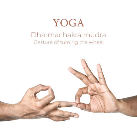 Hands in Dharmachakra mudra by Indian man isolated at white background. Gesture of turning the wheel. Free space for your text photo